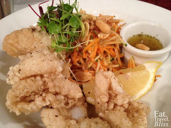 Green papaya squid salad - with Thai dressing, peanuts, and crispy fried onion