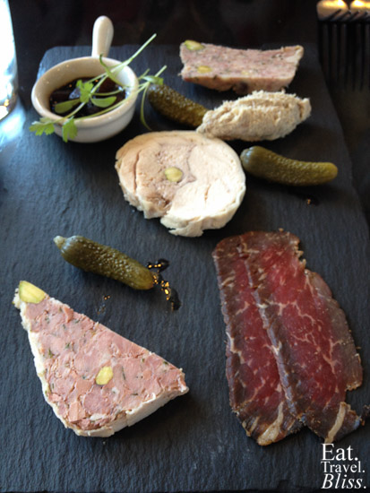 House-made charcuterie and condiments: Thirlmere duck & orange terrine, Burrawong chicken galantine,  pork and pistachio terrine, pork rillettes, wagyu bresaola