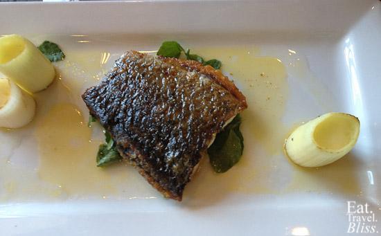 Poisson dur Jour: Barramundi with grilled leeks, potato espuma, lime beurre noisette
